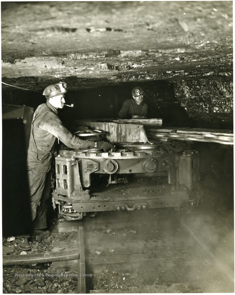 Two miners work with a cutting machine at Mine 206, Kentucky. 'This material is the property of the Consolidation Coal Co. and must be returned promptly to: Advertising Department, Consolidation Coal Company, 30 Rockefeller Plaza, New York, N.Y.
