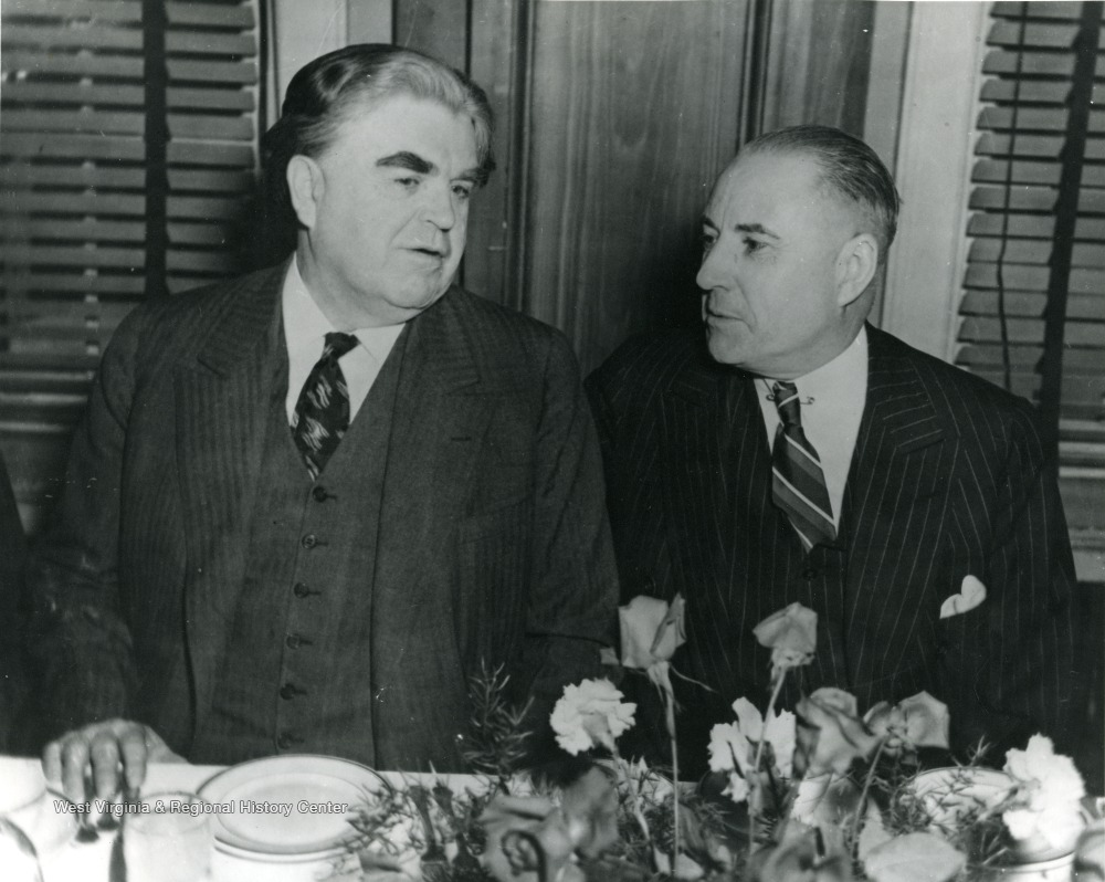 John L. Lewis and M. M. Neely sitting at a table.