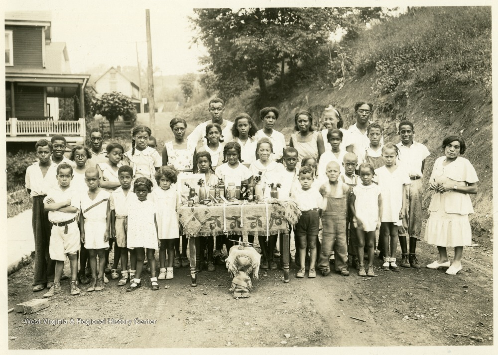 African American Children Displaying Their Crafts