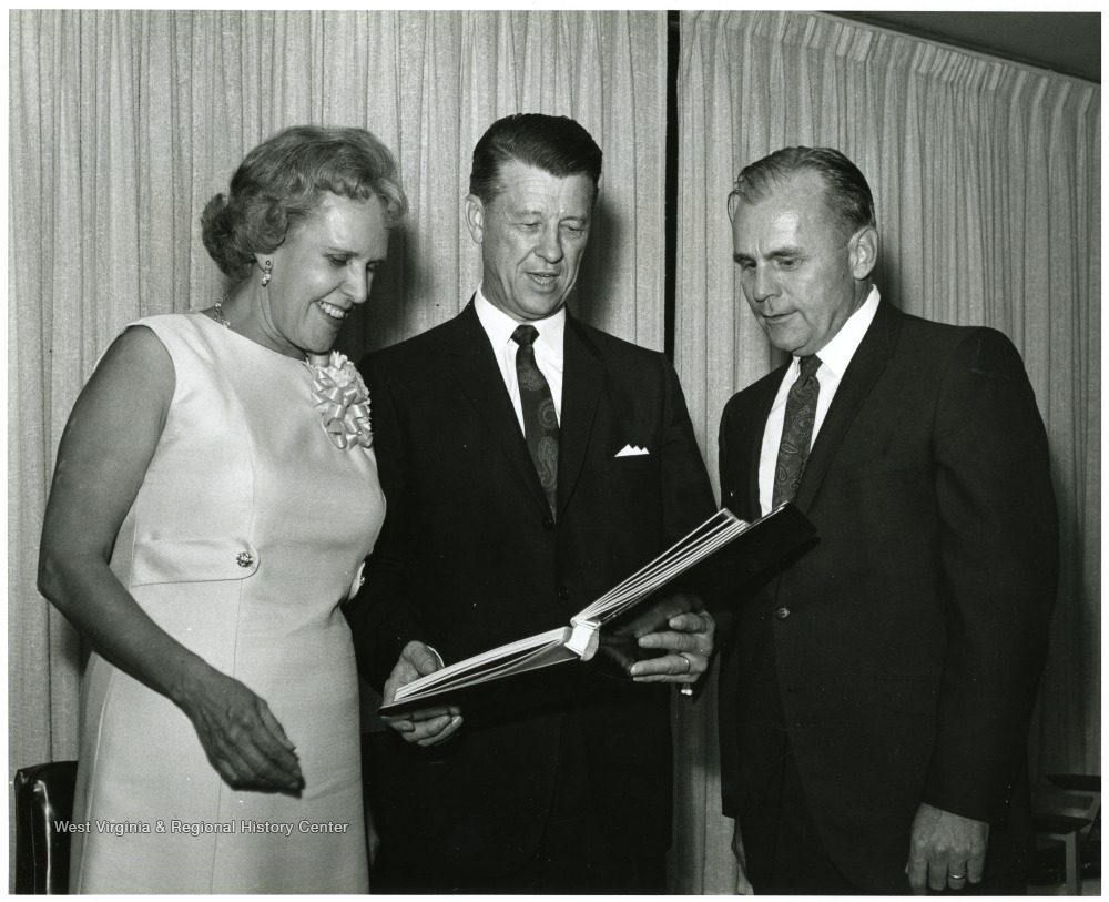 Mr. Shamberger is on the right, President Heflin is in the center, and Mrs. Heflin is on the left. The scrapbook was a present to the Heflins.