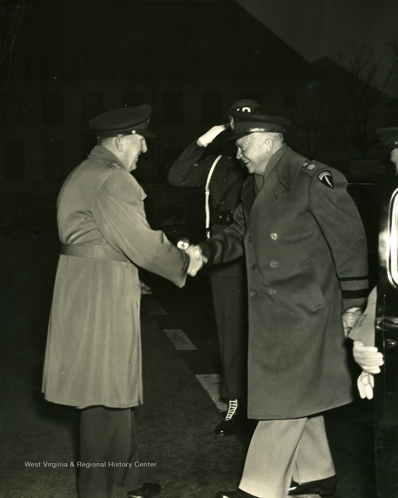 Dwight D. Eisenhower, Supreme Commander of all Allied Forces in the European Theater during World War II, is greeted by an unidentified officer. Eisenhower toured several Nazi Concentration Camps immediately after they were liberated in order to personally testify to the heinous Nazi war crimes.