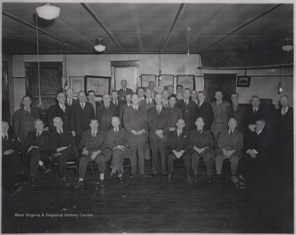 A group of unidentified men gather for a group photo in the building located on Third Avenue.