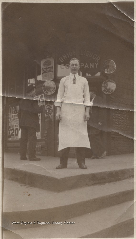 An unidentified man is pictured outside the store entrance located on the corner of Front Street and Third Avenue.