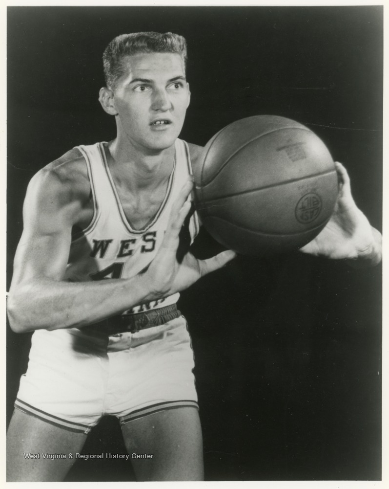 856c2ed101d Jerry West Passing the Ball During a Basketball Game at WVU ...