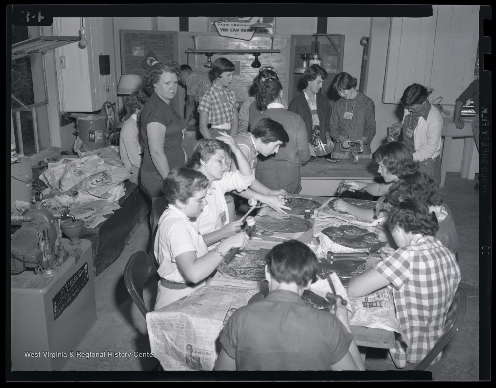A group of female campers produce trays during their class activity. Subjects unidentified.