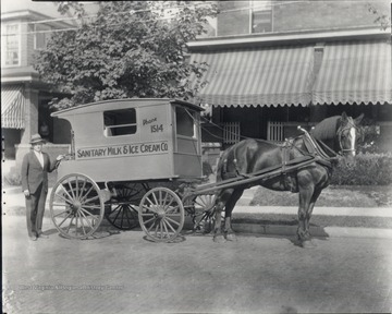 Wagon and salesman are likely standing in front of 253 Park Street in Morgantown, W. Va.