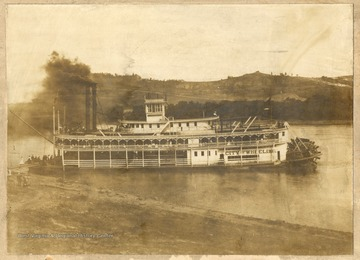 "Steam packet ""City of Wheeling"" conveying church goers on a Sunday school excursion.  This picture shows the boat ""docked"" on the shore of the Ohio River at Narrow's Run."