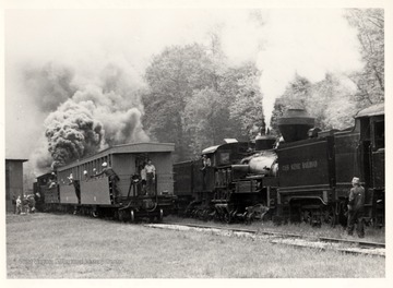 "Bald Knob Trains: 2nd Car Brakeman, Robert Long; Conductor,  Gearold Cassoll;<br />Standing on rear platform: Ken Caplinger; Cab of No. 7, Artie Barkley; On ground, right foreground,  ""Doc"" Carlson; photograph from John P. Killorah, Promotion Officer, WV State Parks, Chas, WV 25305."