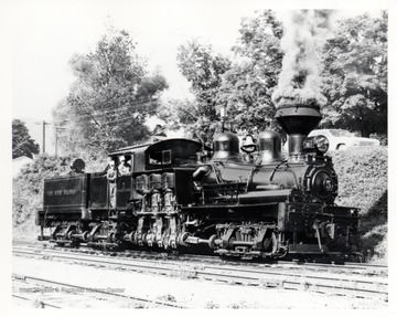 "Locomotive engine with conductors. Cass Scenic R.R. Cass, WV; Artie Bailey in the door; ""Doc"" Carlson at the throttle."