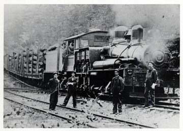 Cass, WV; Second switchback, Cass Hill; Foreground 1-r; 1. Merle Ervin, brakeman 2. Ward Hudson, Conductor 3. Joe Woodell, brakeman; Cab: doorway- Cardock, fireman; throttle- Piney Williams; K.J. Neighbors Collection<br />