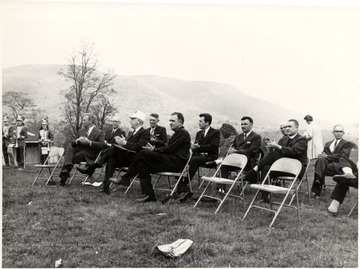 Portrait of dignitaries sitting in chairs on a hillside. Cass, WV; John P. Killoran, Promotion Officer, WV State Parks, Chas, WV 25305