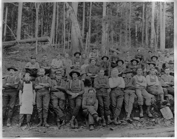 Group portrait of logging crew in woods. From Marshall Blizzard, Bayard, W.Va.