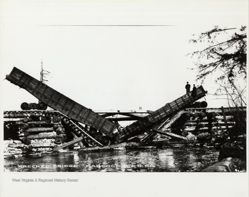 Collapsed bridge and wreck of train box cars.