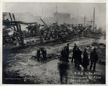 People standing by the remains of the Cherry River Boom and Lumber Co.