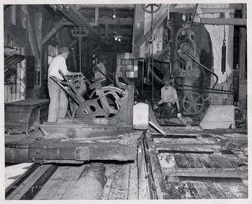 Men working with mill equipment.  L to R  1. Setter, William Simmons (sawed the last log at Cass July 1, 1960)  2. Oliver Tyson  3. unknown.