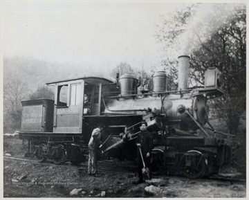Diana, West Virginia.  Two men standing in front of train engine.