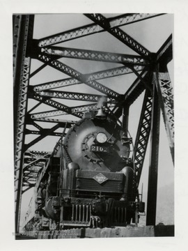 Train engine 2102 on a bridge.