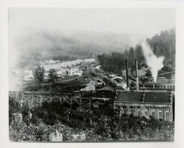 Lumber mill with town in the background.