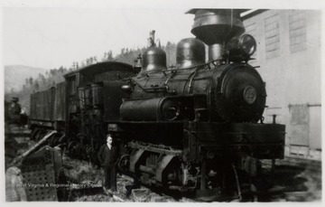 Portrait of Ivan Clarkson standing next to train engine. Sunday afternoon; Ivan Clarkson Collection.