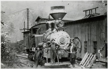 Front view of Shay #1 train engine and 3 men in front of it.  One man in cab.