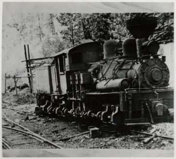 3/4 front view of Shay train engine.