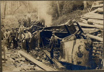 Men stand amongst wreckage.