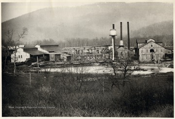 Lumber mill and pond. Three smoke stacks visible.  Greenbrier County.
