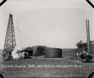 Oil derrick, storage tank, and other equipment.