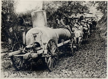 Team of horses pulling a large piece of equipment.