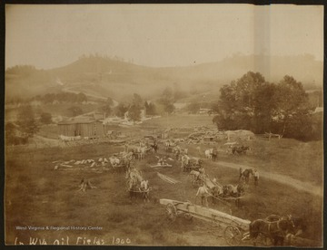 Activities in the oil field near Shinnston, Adamsville area.  Horses, wagons, and man-power moved all the equipment to the drilling site.  Sistersville and Shinnston came into the oil boom about the same time.  E.K. Towles of Shinnston, W. Va.