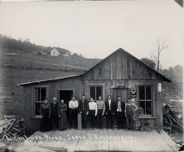 Group posed in front of building.