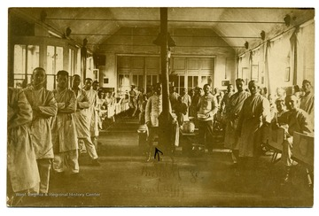 Postcard of interior of field hospital, German Red Cross Number 40, at Wavrin, France.  This was the hospital where Lt. Louis Bennett, Jr. passed away on August 24, 1918 while his wounds were being dressed after his plane was shot down.   Richard Lavril [sic] Ulffz is shown at center.  Postcard came with letter from Mlle. Madelien Dallenne to Sallie Maxwell Bennett, 14 July 1919. Bennett Collection Box 3, Folder 2.