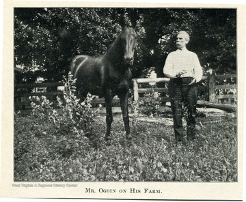 Mr. Ogdin standing beside his horse.