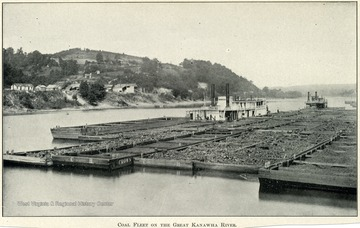 Five barges full of coal lined up on the river.