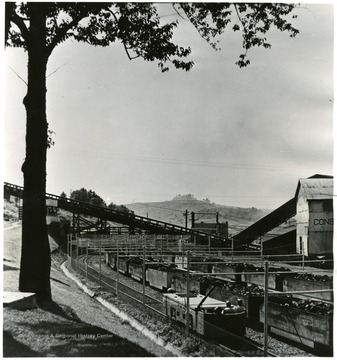 Vandivert No. 32 J-33, 5-9. August 1948. View of safety-fenced mine car unloading yard and personnel overpass, Consolidation Coal Company, Fairmont, W. Va. Bituminous Coal Institute. Feb 1950. 320 Southern BLDG, Washington 5, D.C.