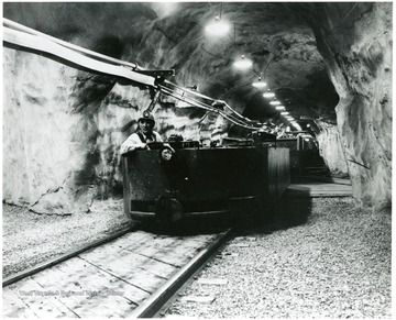 Miner in electric locomotive at the Willow Grove Haulageway, Pittsburgh Consol. Coal Co.