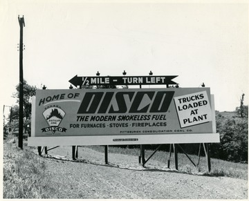 Road sign advertising coal and showing the way to get to the Disco plant. Pittsburgh Consolidation Coal Company.
