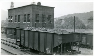 Western Maryland coal car with man on board.