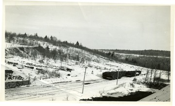 Coal cars on tracks in the winter time.