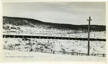 Coal train traveling in the winter at Thomas, W. Va.