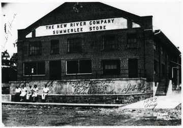 The Summerlee Store at the Summerlee Mine of the New River Company. The people sitting in front of the store from right to left; Harry Stamper, Lola Lewis, A.R. Long, Delia Alexander, A.J. Bishop.