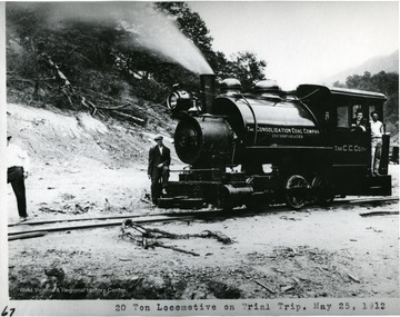 Men posing with the Consol. Coal. Co. Locomotive No. 2 on its trial trip.