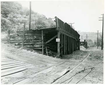 Unidentified coal loading platform alongside railroad tracks.