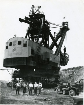 Group Portrait of Men Standing Below the Tiger Coal Shovel