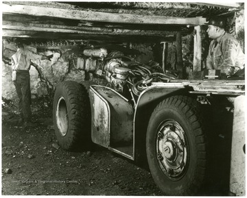 Caption on back reads, 'Making a cut in the coal face is this Mastodon of the machine age - an underground cutter.  Rubber tired for mobility, and mounting a 9-foot cutting blade armed with whirring steel bits, it can cut a full 360 degree arc.  This and similar machines give America's bituminous coal mines almost unlimited capacity for production.'
