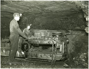 Two men cutting coal in the parting.