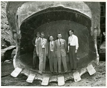 Five men standing in the Mountaineer Scoop.