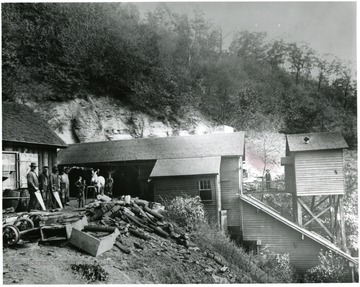 Men standing outside of the No. 2 Head House of the Thurmond Coal Co.