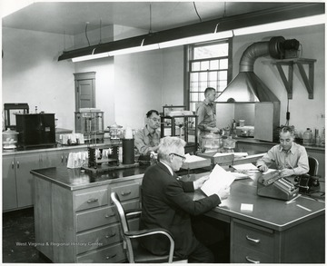 Four men working in the Pocahontas Fuel Company laboratory.