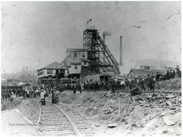 Crowds gather around the smoking buildings after an explosion at the Eccles mine.